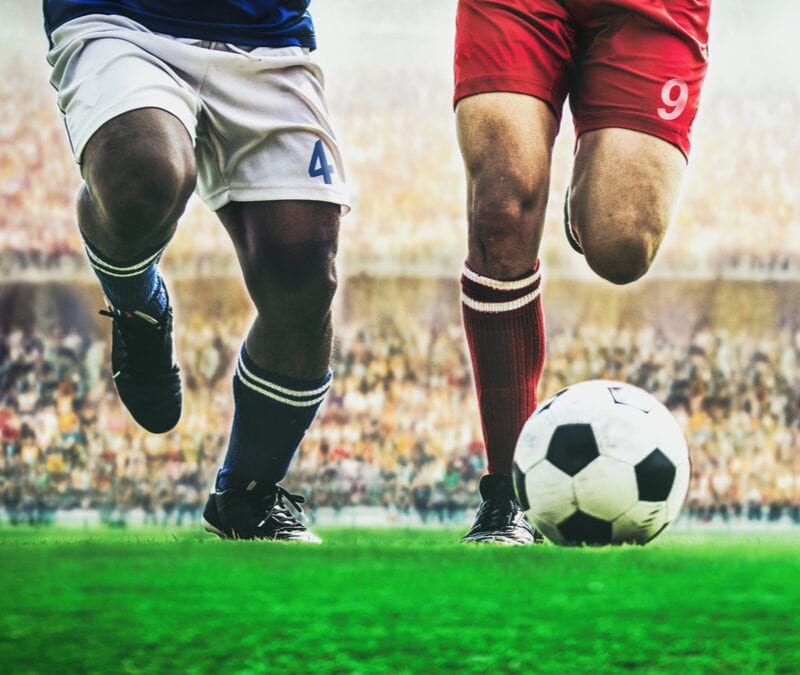two-soccer-players-on-a-field